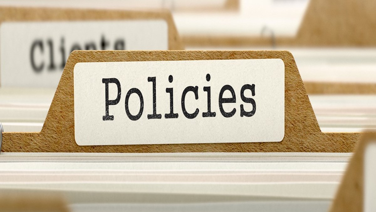 """Image of file folders with various labels. The label on the folder in focus says """"Policies."""""""